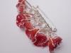 red line brooch
