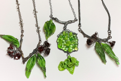 Turning over a new leaf neckpieces, silver and glass